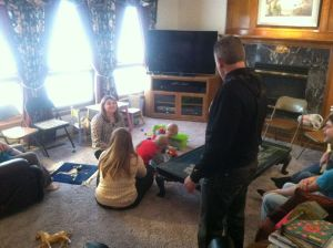 Stephanie keeping her twins entertained with the help of Kelly and his daughter Kennedy.